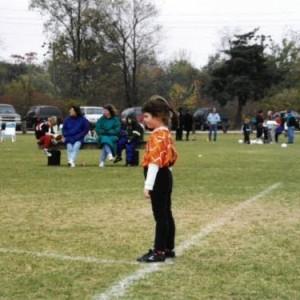 Tori Walker stands in a sportsball field.