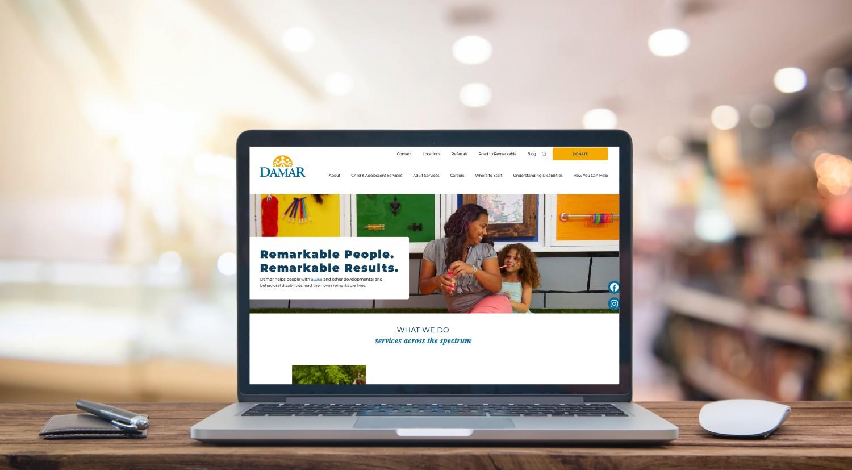 Damar website on laptop screen