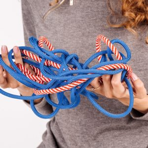 Woman unraveling knot