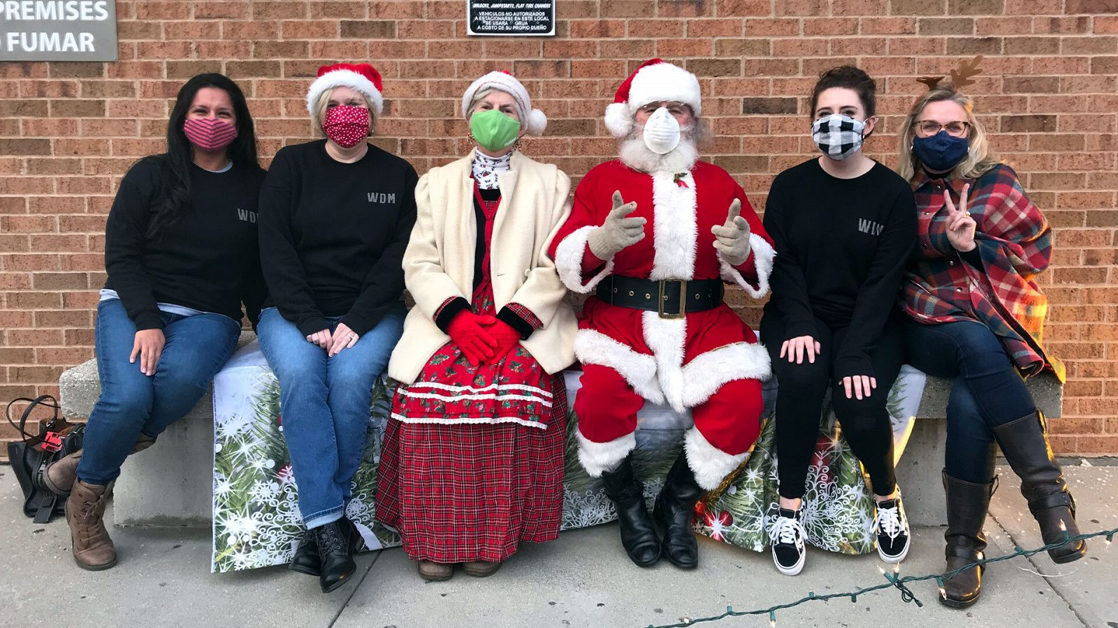 Well Done Markters with Santa and Mrs. Clause