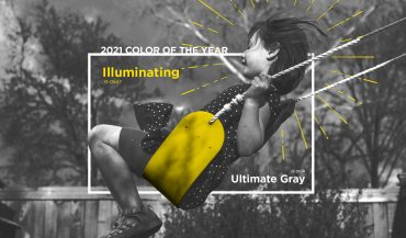 "Black and white photo of girl on ""Illuminating""-colored swing"