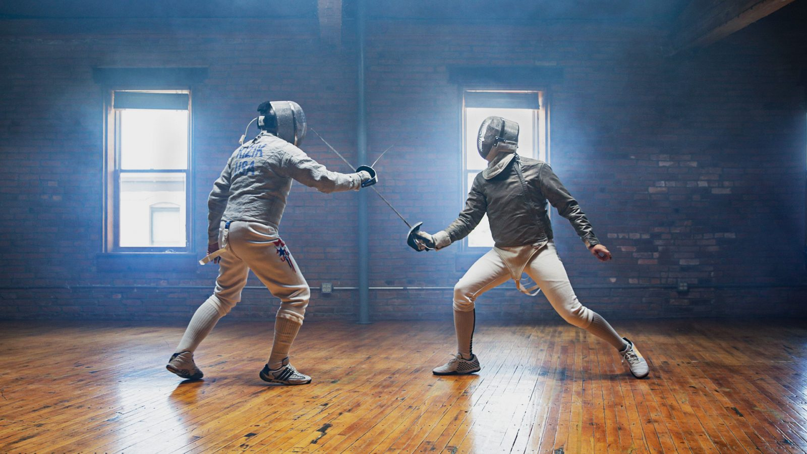 Scene from video: two athletes fencing