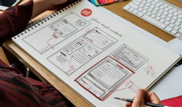 Website wireframe sketches in a notebook