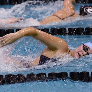 Kylie Mihok swimming in competition