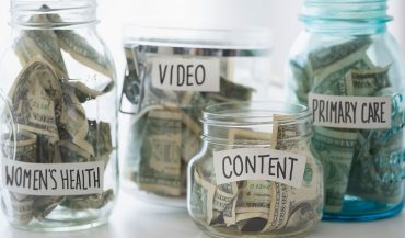 Jars of cash with healthcare marketing labels