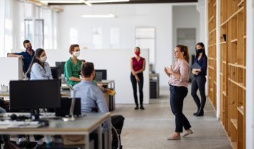 Social distanced team meeting in office